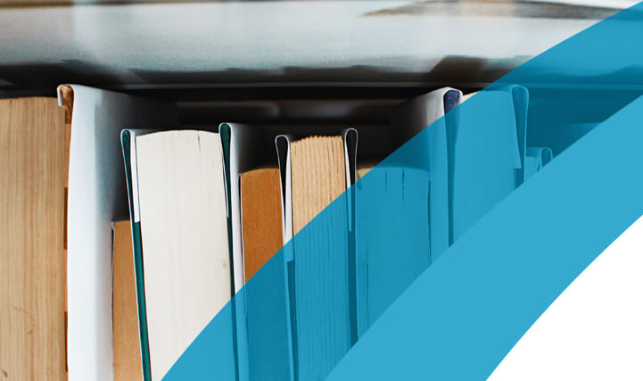 Close-up of 7 Books on a Shelf - For Eliminating Agency Costs & Reducing Time To Fill.