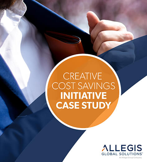 Man Wearing a Blue Blazer, While Putting His Wallet in His Blazer Pocket - For Creative Cost Savings Initiative Case Study.