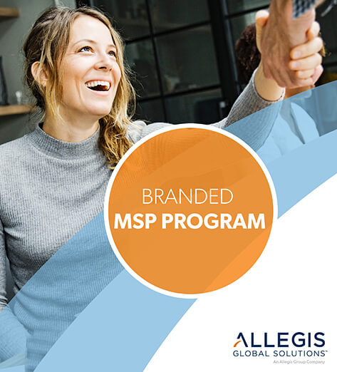 A Woman Smiling and Shaking Hands with Another Person - For Branded MSP Program.