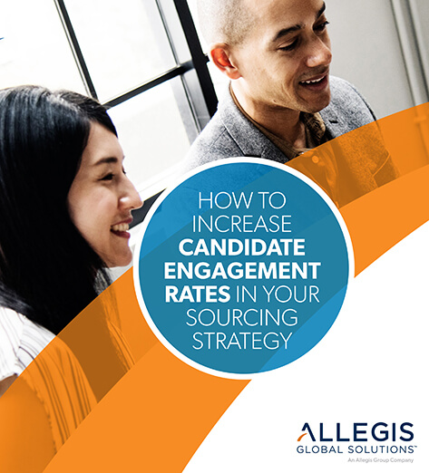 Two Professionals Smiling - For How To Increase Candidate Engagement Rates In Your Sourcing Strategy
