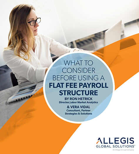 Single Woman Sitting At Her Laptop Working - Flat Fee Payroll